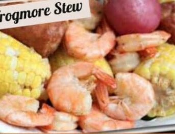 A close up of shrimp, corn on the cob and potatoes with text above them.