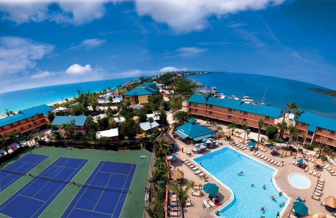 An aerial view of a vacation resort on the ocean.