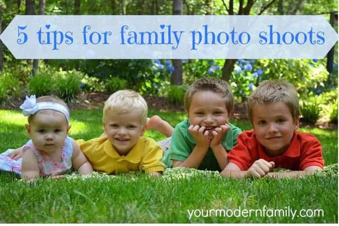 Small children lying in the grass posing for a picture with text above them.