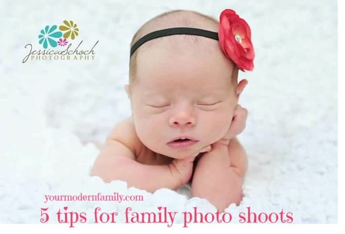 A  baby sleeping while having her picture taken.