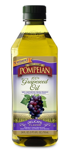 A close up of a container of Pompeian Olive oil.