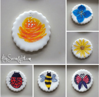 A close up of variety of cupcake toppers with different designs on them.