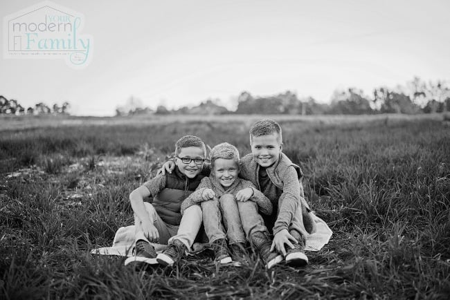 brothers sitting in a field