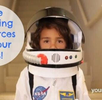 A child in an astronaut's uniform with text beside him.