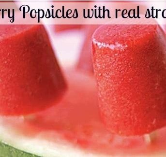 A close up of a strawberry popsicles made with real strawberries.