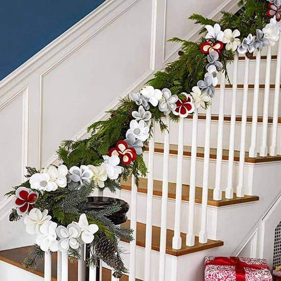 A staircase decorated for Christmas.