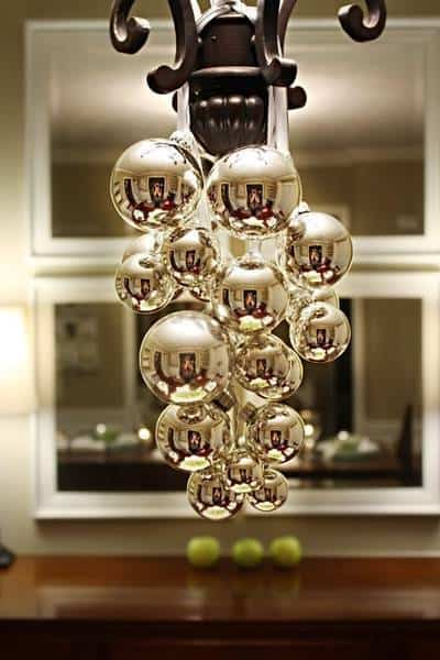 Christmas decorations and garland hanging from the light above the table.