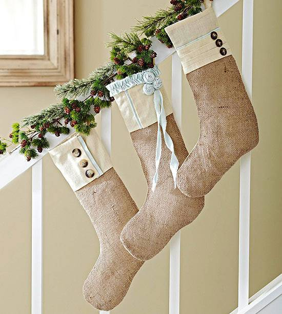 A staircase with Christmas stockings hanging on it.