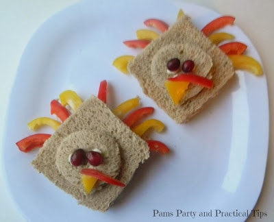 Two turkey shaped sandwiches on a plate.