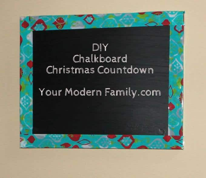 A completed DIY chalkboard Christmas Countdown hanging on the wall.