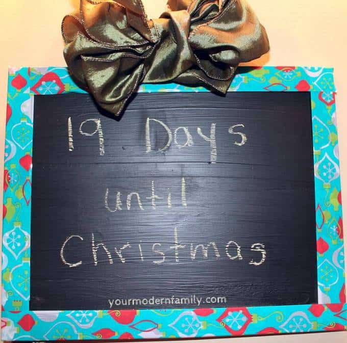 A close up of a framed chalkboard countdown with text on it.
