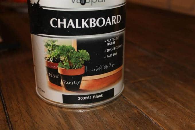 A can of chalkboard paint on a table.