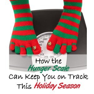 A close up of a person on a scale wearing Christmas stockings with text below her.