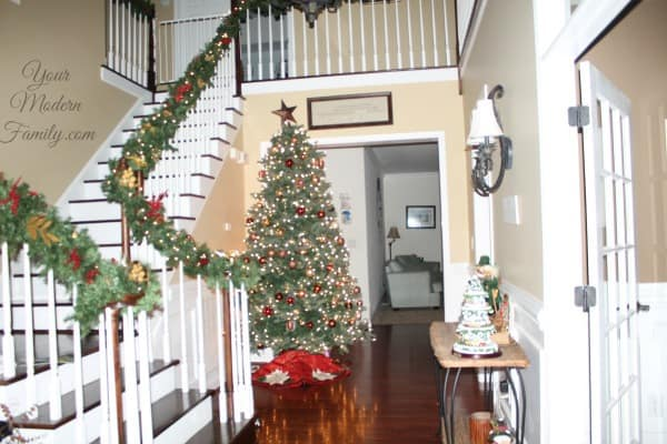 An entrance way with a Christmas tree and decorations.