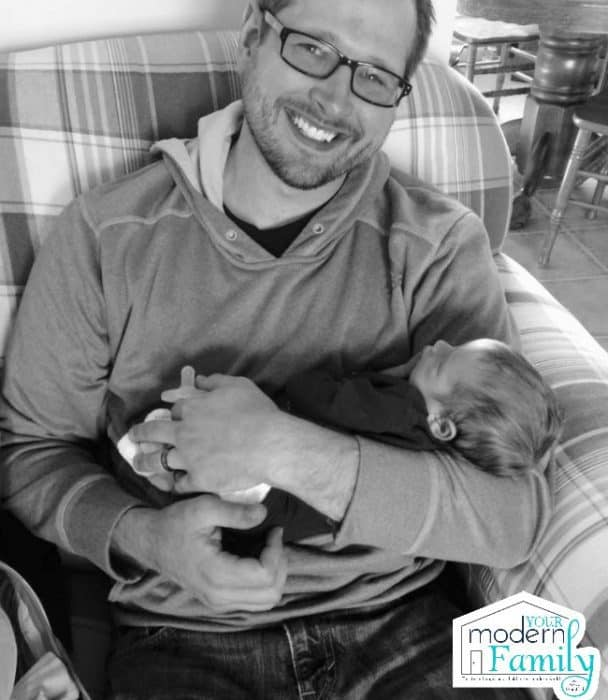A man holding a baby in his arms.