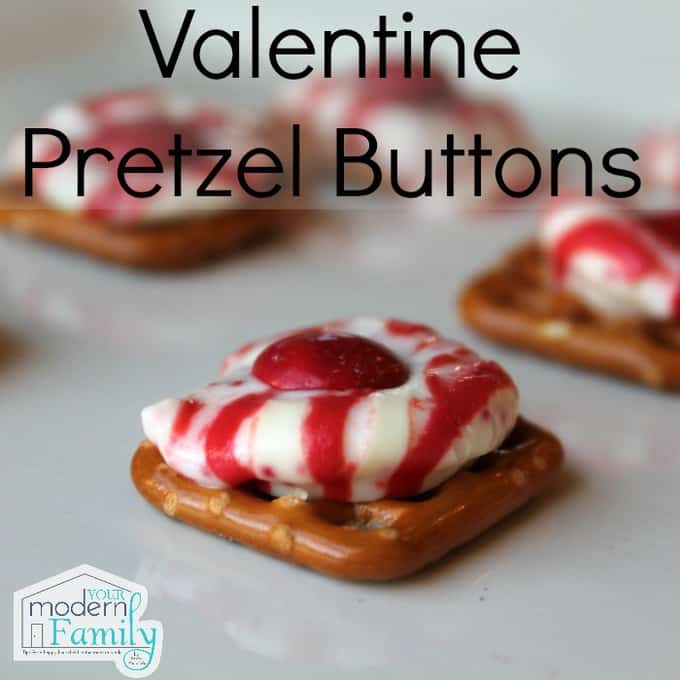Square pretzels with a melted mint and a piece of candy on top.