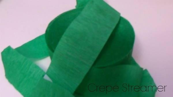 A close up of a green crepe paper.