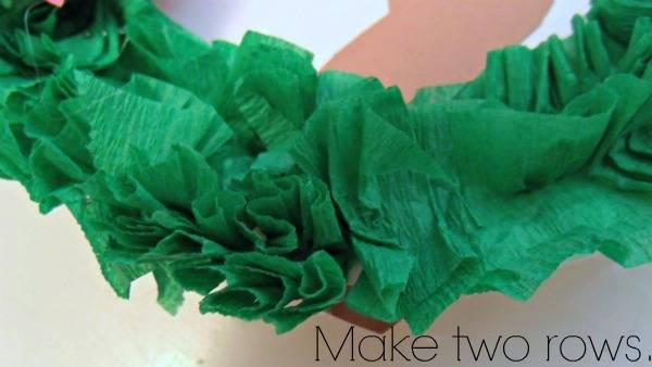 Green crepe paper glued to a white paper plate.