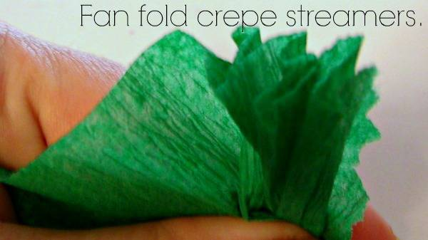 A close up of green crepe paper with text above it.
