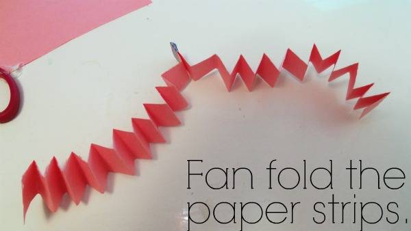 Folded construction paper with text below it.
