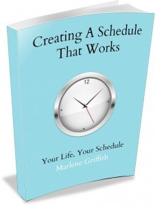 A book on creating a schedule with a picture of a clock on it.