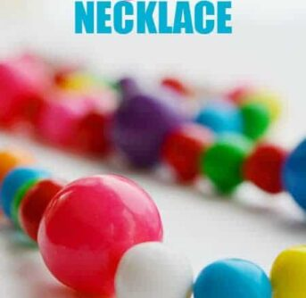 A necklace made of gumballs and text above it.