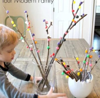 A boy making an Easter Tree with jelly beans.