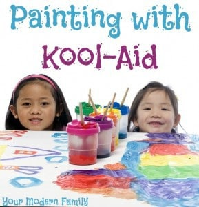 A two little girls sitting at a table with Kool-Aid paints in containers and text above them.