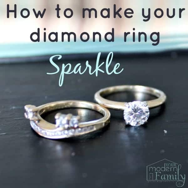 Two diamond rings sitting on a counter with text above them.