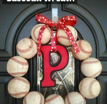 A front door with a wreath made out of baseballs.