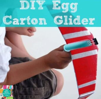 A boy holding a Glider made from an egg carton with text above him.