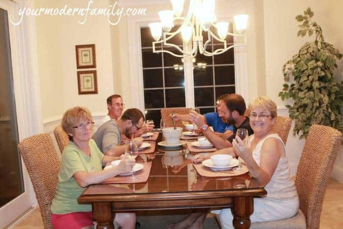 A group of people sitting at a dinner table.