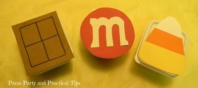A close up of a M&M logo on a plastic container.