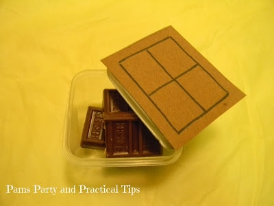 A plastic container with Hershey bars in it with a drawing of a Hershey bar on top.