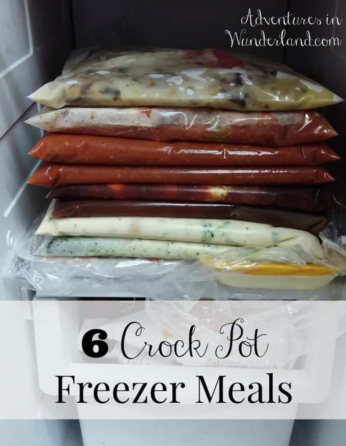 Frozen meals in plastic bags stacked in the freezer.