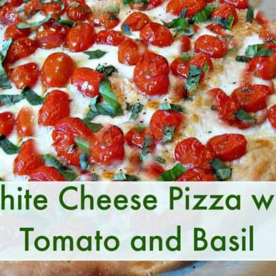 white cheese pizza with tomato and basil