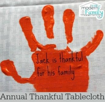 A craft of a child's painted hand print with text on it.
