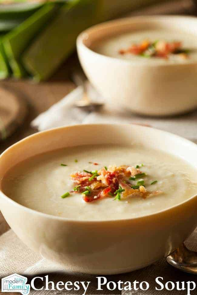 A bowl of Cheesy Potato soup sitting on a table.