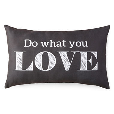 A black pillow with text on it.
