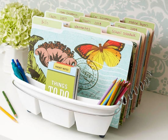 A dish strainer turned into an organizer holding folders and pencils.