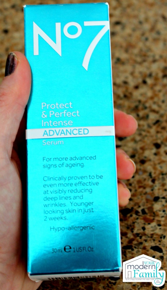A hand holding a box of No. 7 product.