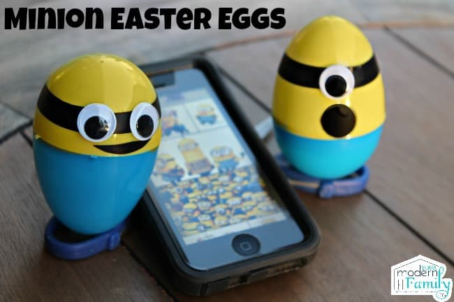Two minion Easter eggs with a cell phone sitting between them.