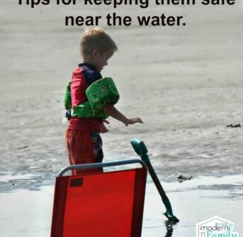 A little boy that is standing near the water wearing a puddle jumper for safety with text above him.