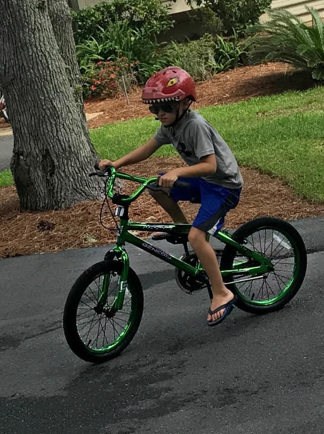 A boy riding  a bicycle.