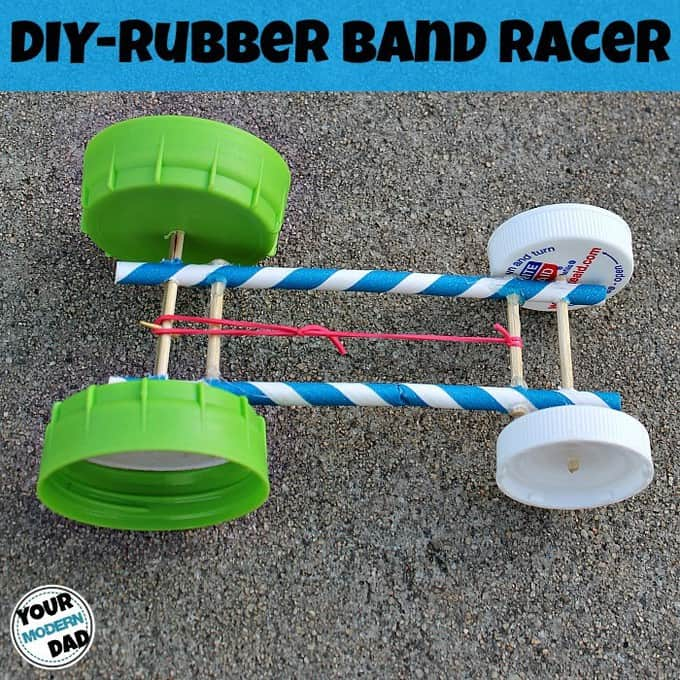 Rubber band car made with straws and plastic lids.