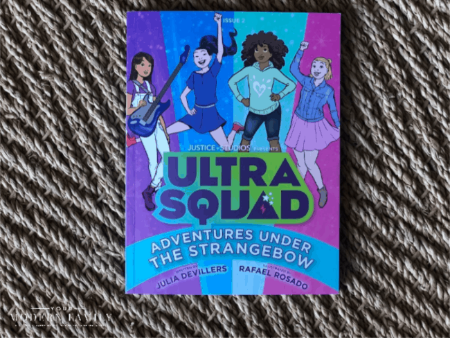 A book with drawings of girls dancing on the cover.