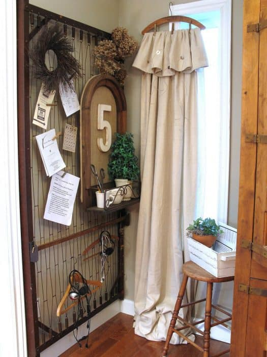 A bed frame repurposed into a entry way decoration.