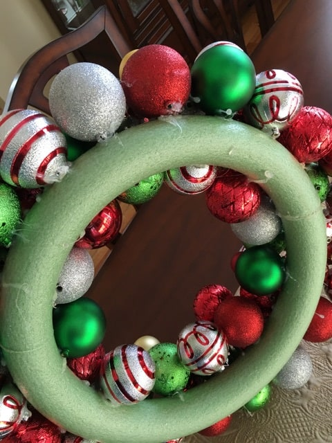 A view of the back side of a Christmas ornament.