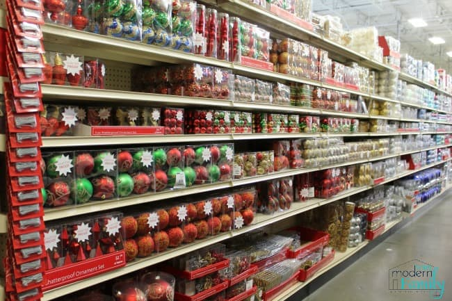 A store shelf filled with Christmas decorations.
