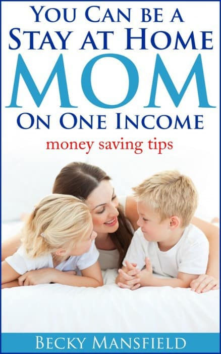 A cover of a book with a woman and two kids lying on the floor with text above them.